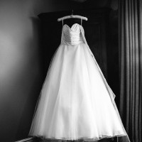 the wedding dress hanging on cupboard