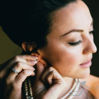 bride putting on earings