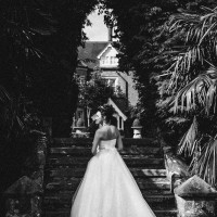Bride in black & white one the steps