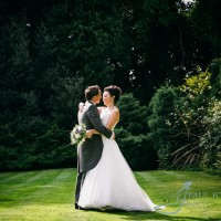 bride & groom in the gardens of Alexander House Hotel in Sussex