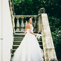bride on the step behind the spa at Alexander House in Sussex