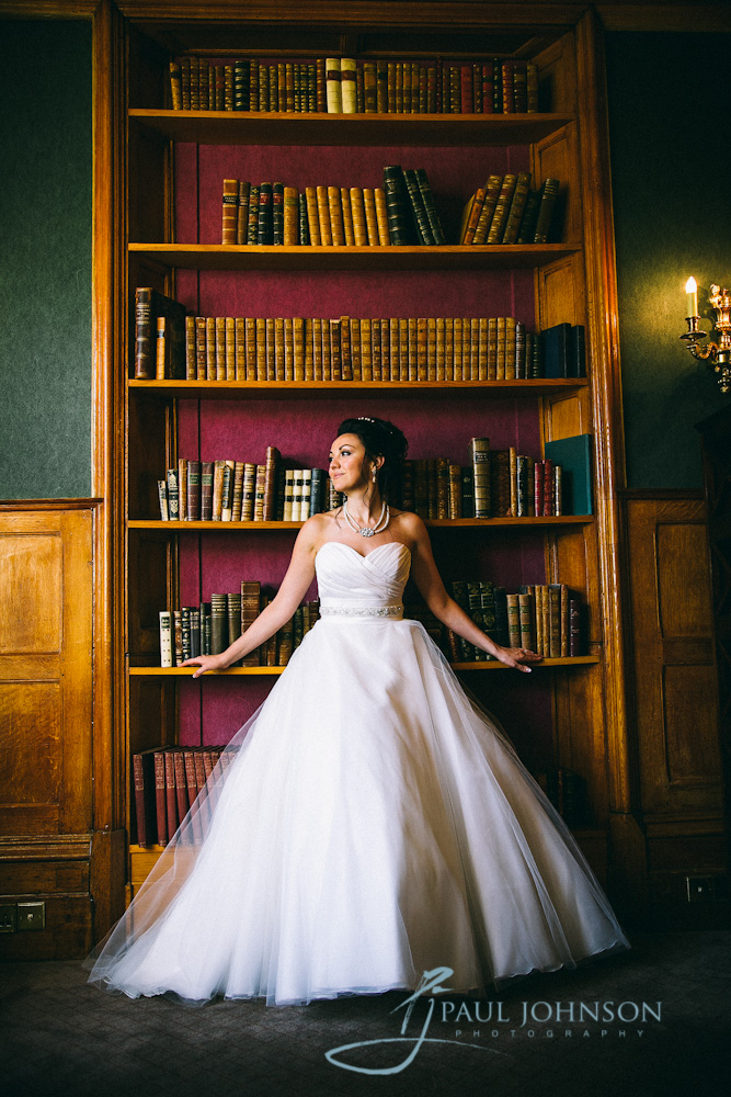 Bride in library in colour at Alexander House Hotel, Turners Hill