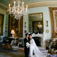 wedding photograph of bride and groom in the study at Goodwood House