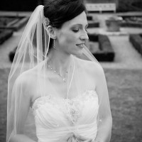 black & whiet bride photo in the gardens of Clandon Park