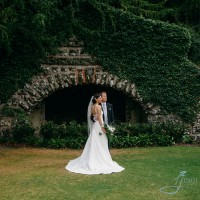 bride & groom photo in the gardens of Clandon Park