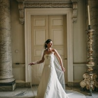 bride in beautiful pose in the hall at Clandon Park