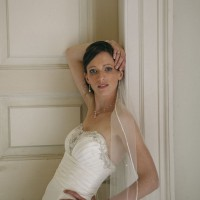 bride portrait leaning against a wall