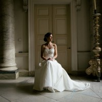 bride seated in beautiful pose. window lit