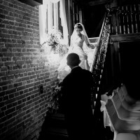 bride walking down stairs at cooling castle barn