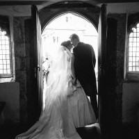couple kissing as they leave the church