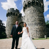 bride and groom in front of cooling castle