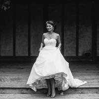 bride walking toward camera in black & white