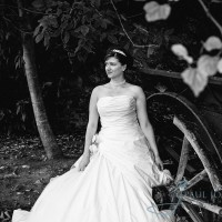 bride next to cart at the cooling castle barn