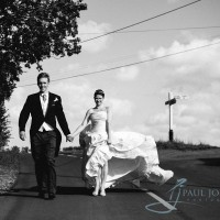 bride & groom walking in teh road in black & white