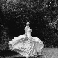 bride twirling her dress in black & white