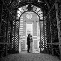 hampton court palace wedding photo of bride and groom under the pergola
