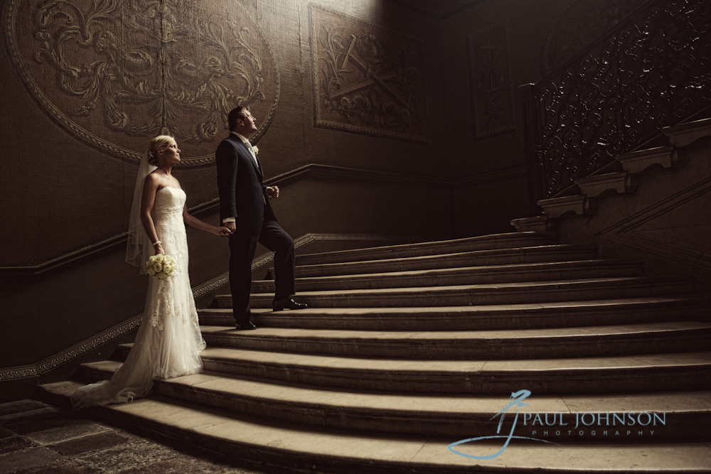 the staircase in hampton court palace wedding photo of bride and groom
