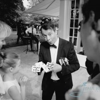 Magician at a wedding doing a card trick