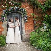 chatting brides in the walled garden cowdray, wedding photography