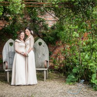 two brides together in the walled garden cowdray