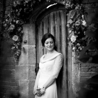 the gate in to the walled garden cowdray, wedding photograph
