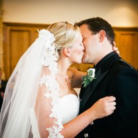 couple kissing south lodge wedding