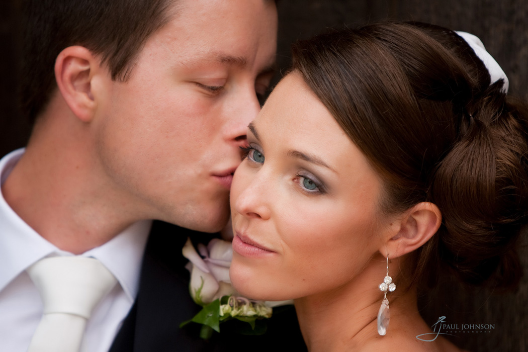 A kiss from her groom, wedding day photography