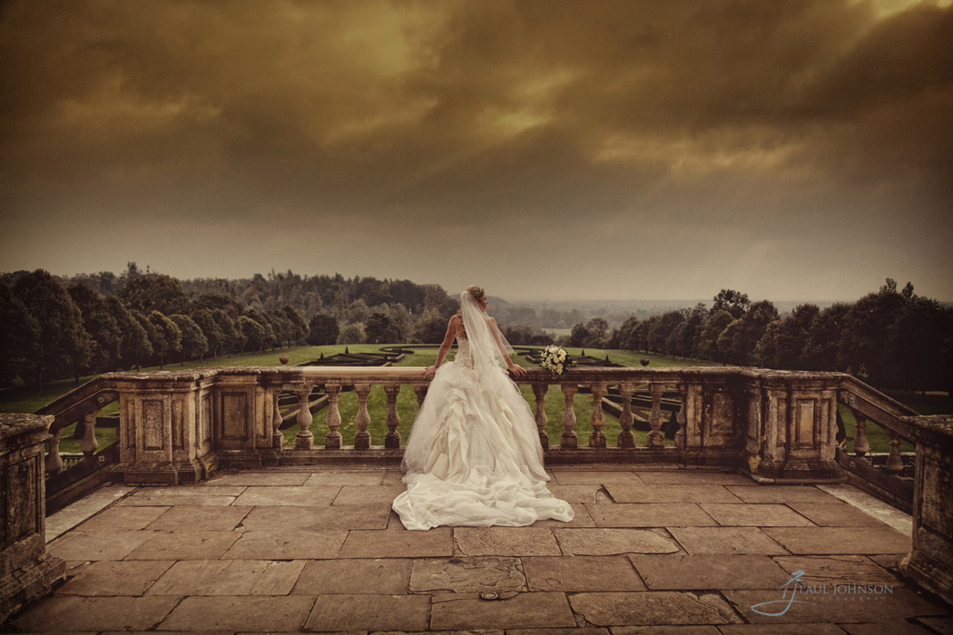 Back of brides dress on the terrace of Cliveden House, Berkshire