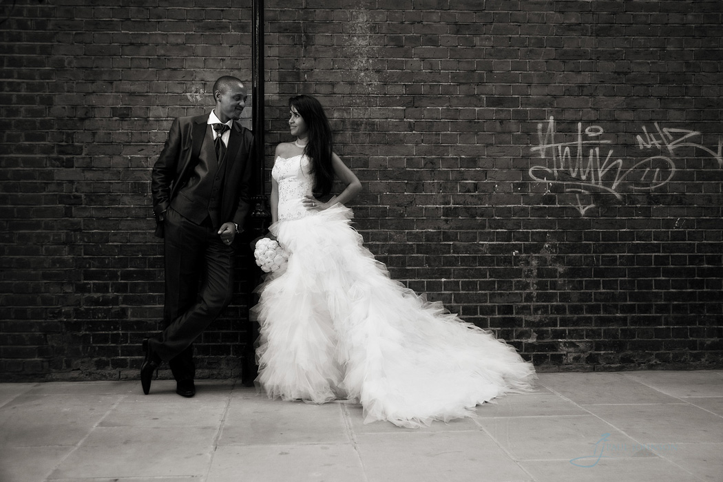 Contemporary wedding day photo against brick wall in Knightsbridge
