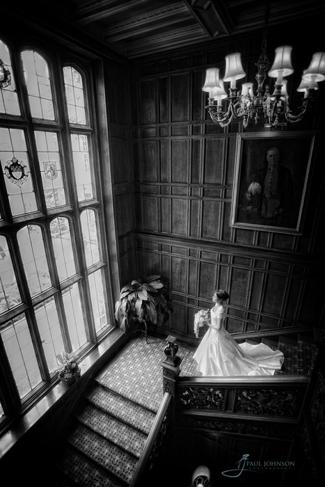 Black & white wedding photography on the stairs at country house hotel in England