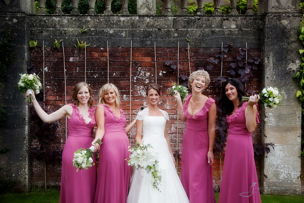 Bride having fun with her bridesmaids on her wedding day