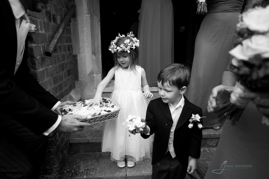 Pageboy and flower-girl with confetti
