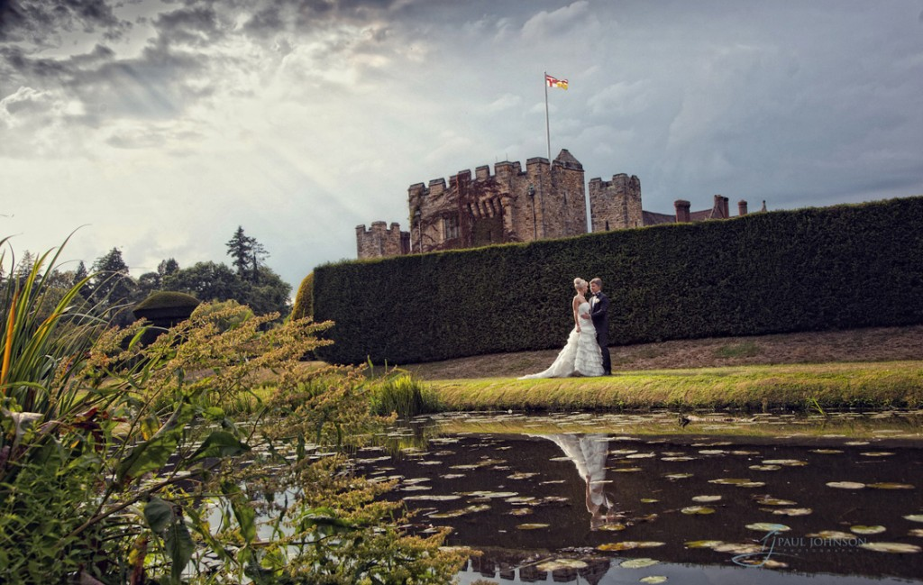 The crepuscular rays on a wedding day photo at Hever Castle