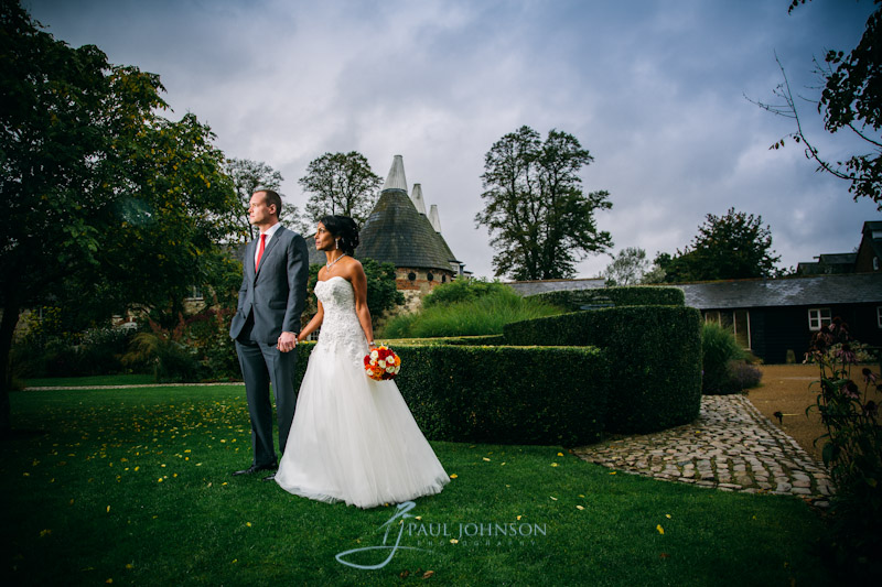 In the gardens at Bury Court, bride & groom creative wedding photo with off camera flash