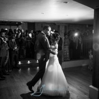 Couple's first dance together in black & white