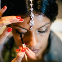 Indian bride having make up applied