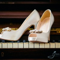 The brides shoes on a piano