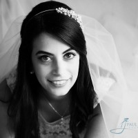Bride black & white photo laying on bed