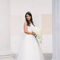 Bride full length colour portrait among columns
