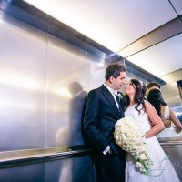 Bride & Groom in the lift kissing at the Brewery