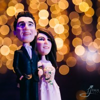 Bokeh of bride & groom on wedding cake