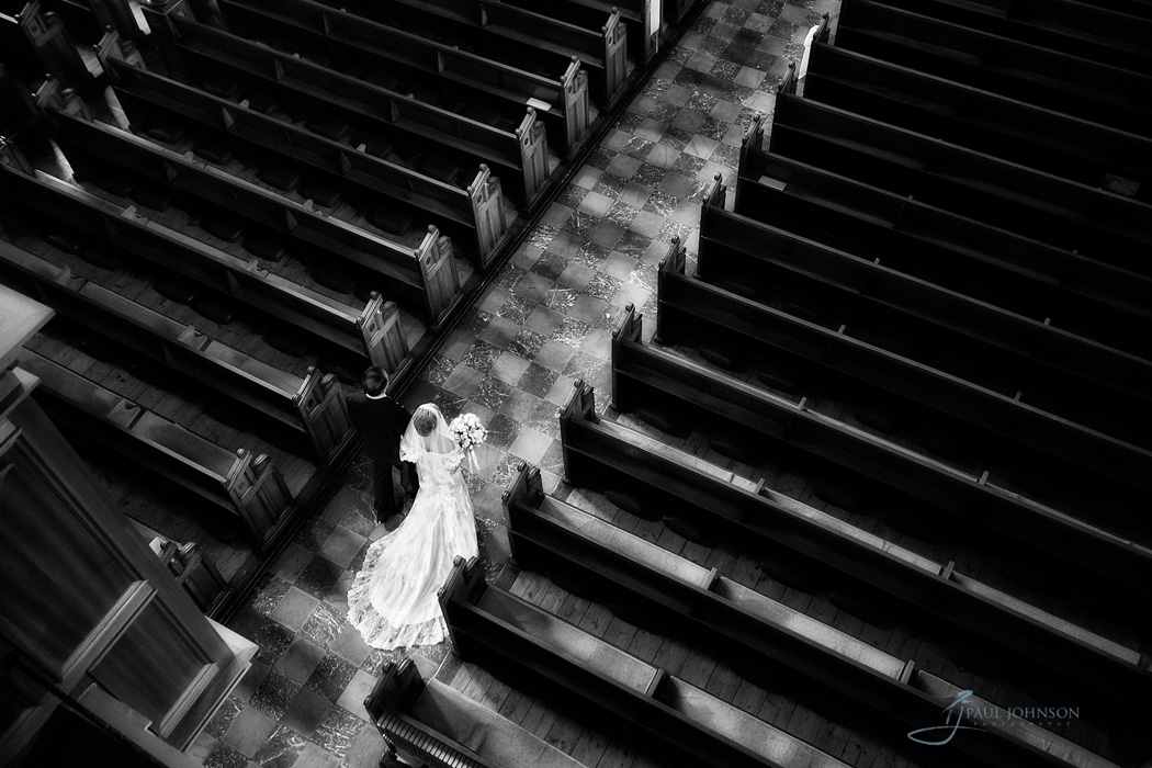 Areal photo of bride walking up the aisle in black & white