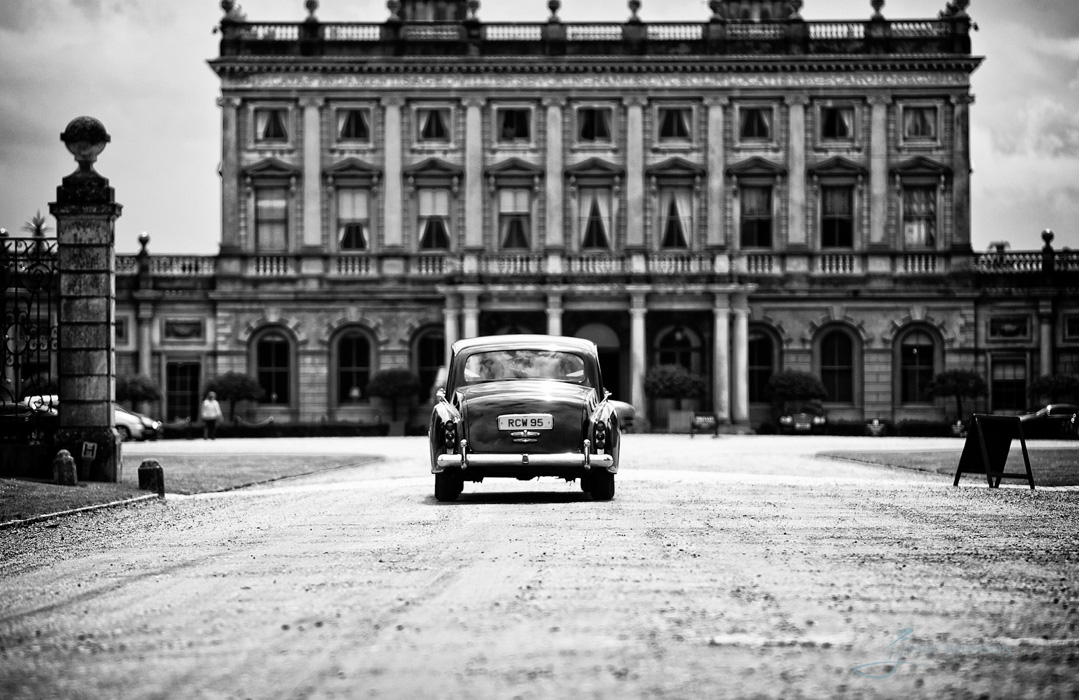 Wedding car approaching Cliveden House on the drive, black & white photo
