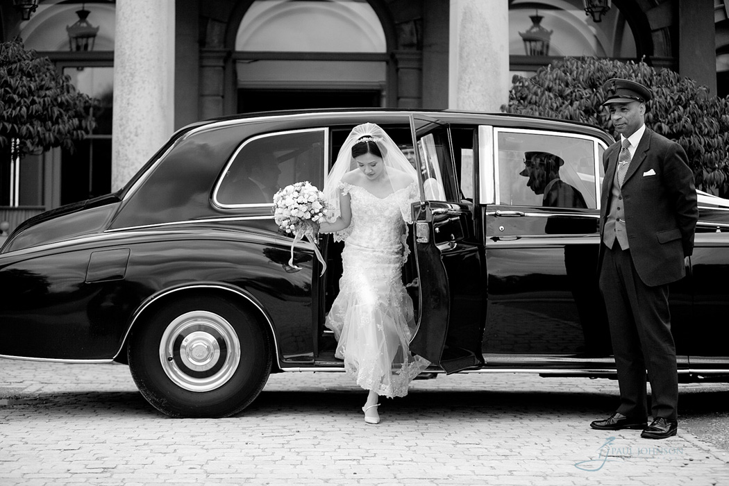 Chauffeur letting bride out the car