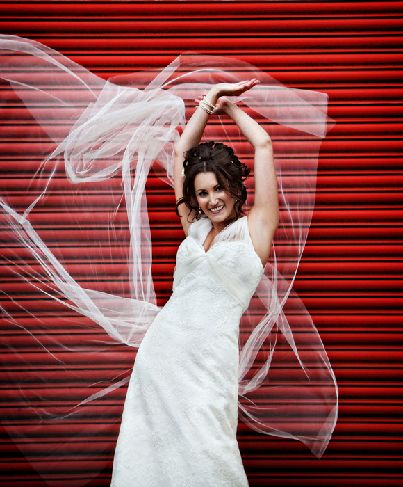 A dynamic colour bridal photo, playing with veil