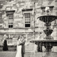 couple by fountain on wedding at Botleys Mansion