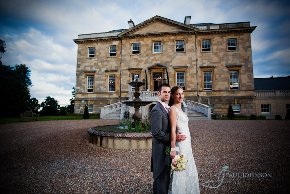 Bride & groom at the front of Botleys Mansion