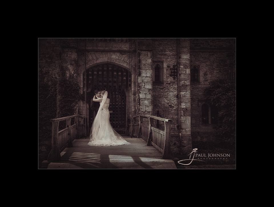 The drawbridge with bride & groom at Hever Castle wedding day