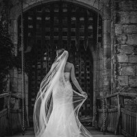 Hever Castle wedding photo on drawbridge